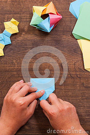 Free Child Puts The Modules. Children`s Creativity Made Of Paper, Origami Crafts, Handicrafts For Children. Handmade. On Wooden Table Royalty Free Stock Photography - 93889187