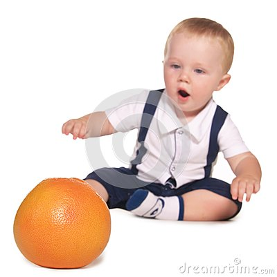 Child reaches out to orange, focus on oranges
