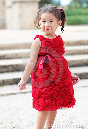 Child in a red flower dress