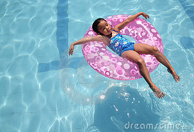 Child relaxing at the pool