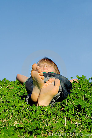 Child relaxing sleeping outdoors