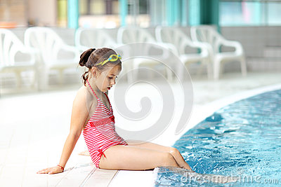 Child relaxing by swimming pool