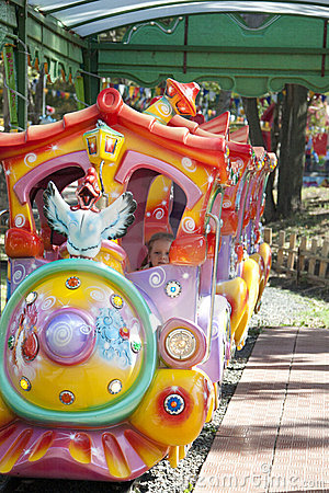 Child rides in the summer attraction in the park.