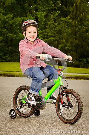 Child riding bike with safety helmet