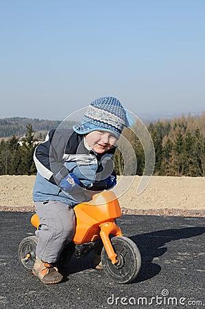 Child riding motorbike
