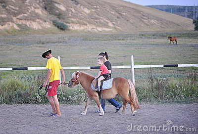 Child riding pony Editorial Image
