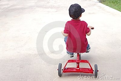 Child riding a tricycle