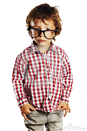 Child with rimmed glasses and hands in pockets
