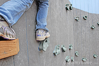 Child on rock climbing wall