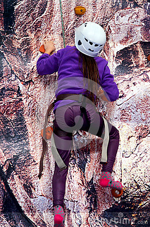 Child rock wall climbing