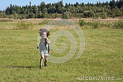 Child running across field