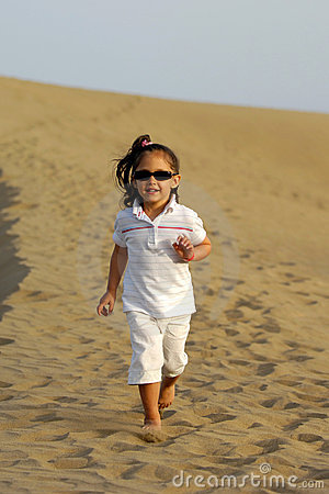 Child running in desert