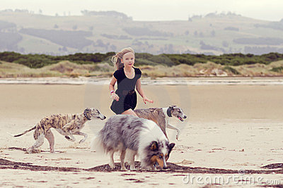 Child running with dogs