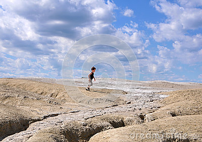 Child running between earth and sky