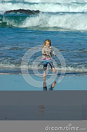 Child running in sea