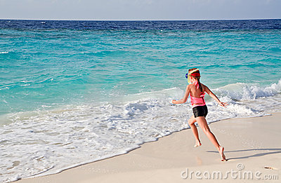 Child running to ocean