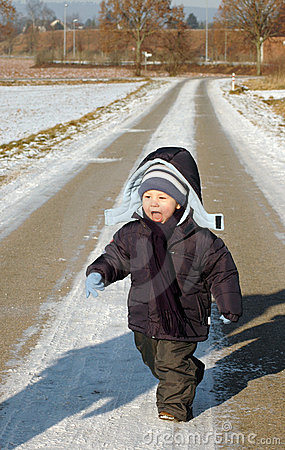 Child runs on the road.