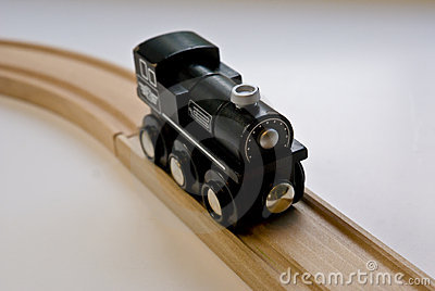 Child's Black Wooden Toy Train On Wood Tracks Royalty Free Stock Image - Image: 12978566