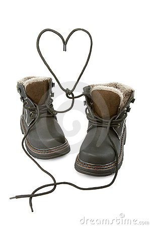 Child s boots form a heart with shoelaces.