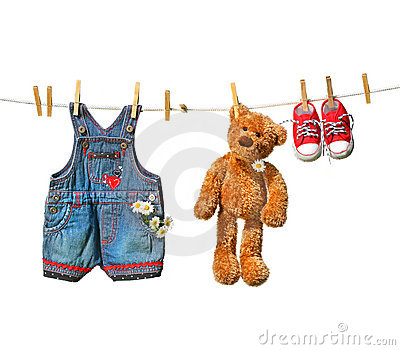 Child s clothes with teddy bear on clothesline