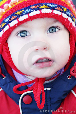 Child s face in a cap
