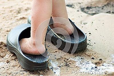 Child s feet in big sandals