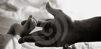 Child s foot in the father s hand