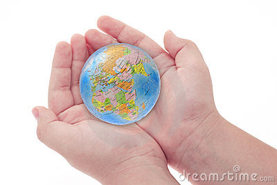 Child s hands holding jigsaw puzzle globe
