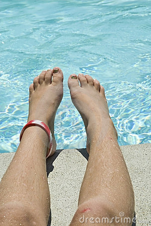 Child s Legs on Side of Pool