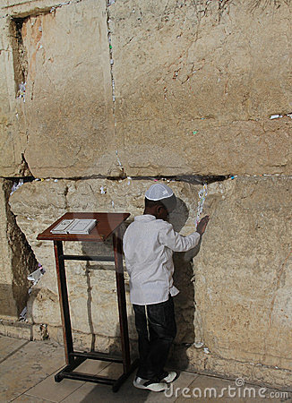 Child s prayer at the Wailing wall Editorial Photography