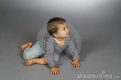 Child  in sailor s striped vest crawl