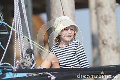 Child sailor traveling on sea yacht
