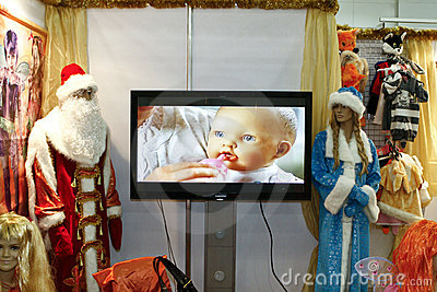 The child, Santa Claus and Snow Maiden suits Editorial Stock Image