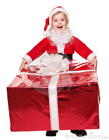 Child in santa costume giving gift box.