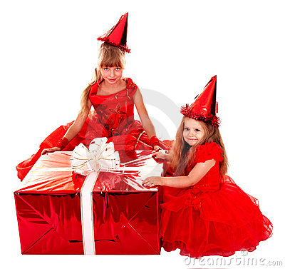 Child in santa  hat with christmas red gift box.