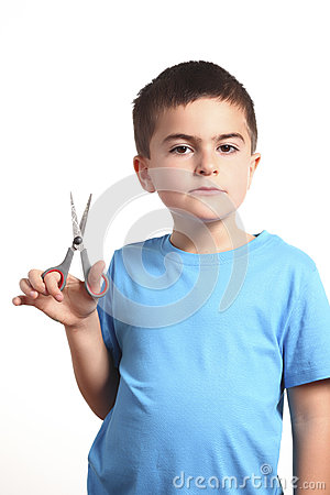 Child with scissors on white