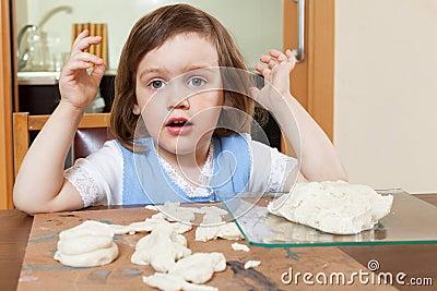 Child sculpts dough figurines Stock Photo