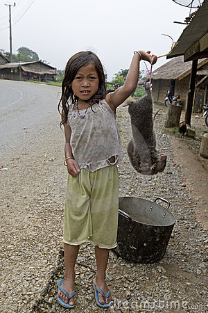 Child sell mole for a meal, Laos