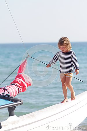 Child on ship on sea background