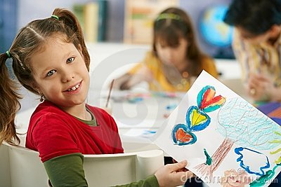 Child showing painting in art class