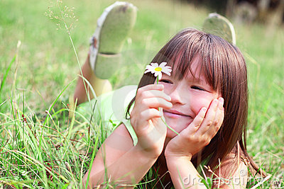 The child sit on a grass