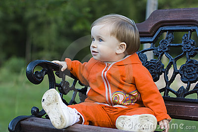 Child sitting on the bench