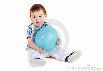 Child sitting with blue baloon