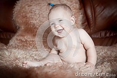 Child sitting on fur