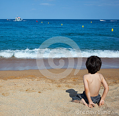 Child sitting on the shore