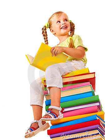 Child sitting on stack of books.