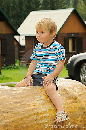 Child sitting on trunk