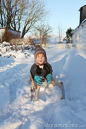 Child on sledge or sleigh winter snow