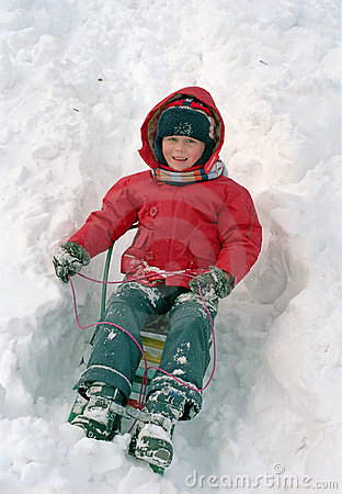 Child sledge on snow