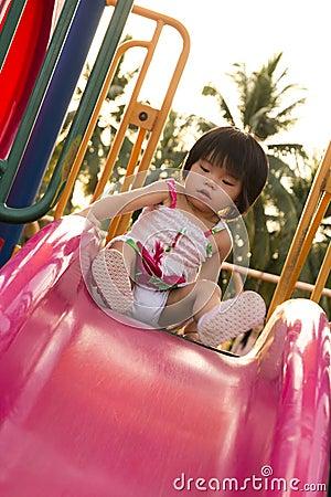 Child on a slide in playground